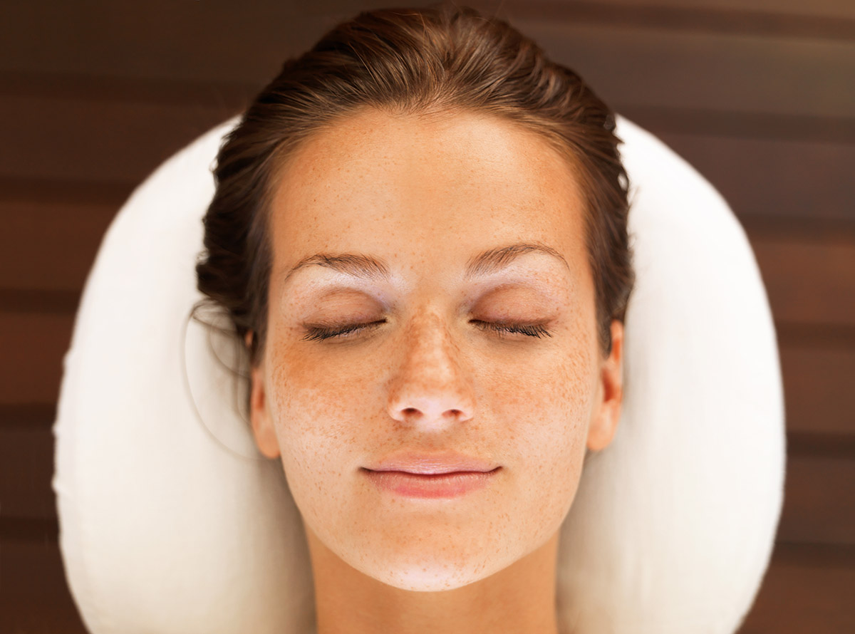 Closeup portrait of a beautiful young woman enjoying a spa day and daydreaming